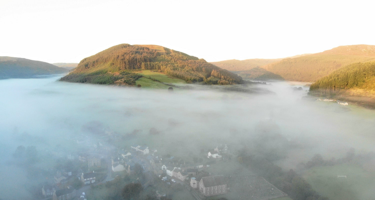 5am on a summer morning looking down to the village of Penmachno